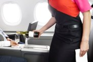 Qantas's Aquire program offers companies the option of rewarding employees with a business class upgrade.