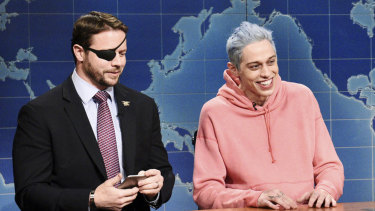 Lt. Com. Dan Crenshaw, a congressman-elect from Texas, with Pete Davidson on Saturday Night Live's Weekend Update.
