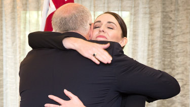 Scott Morrison and  Jacinda Ardern hug following Friday's service for those killed in Christchurch.