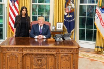 President Donald Trump with Kim Kardashian in the Oval Office in 2018.