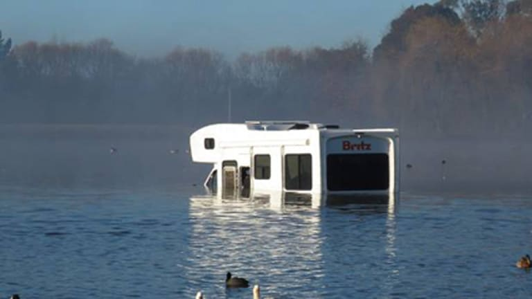 Stranded: The campervan shares Henley Lake with a handful of ducks.