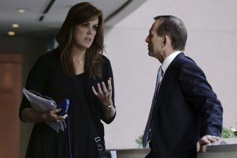 Peta Credlin and Tony Abbott on the campaign trail in 2013.