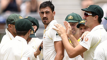 Fired up: Mitchell Starc looks back to Indian batsman Murali Vijay after he was dismissed for a duck on day two of the second Test match.