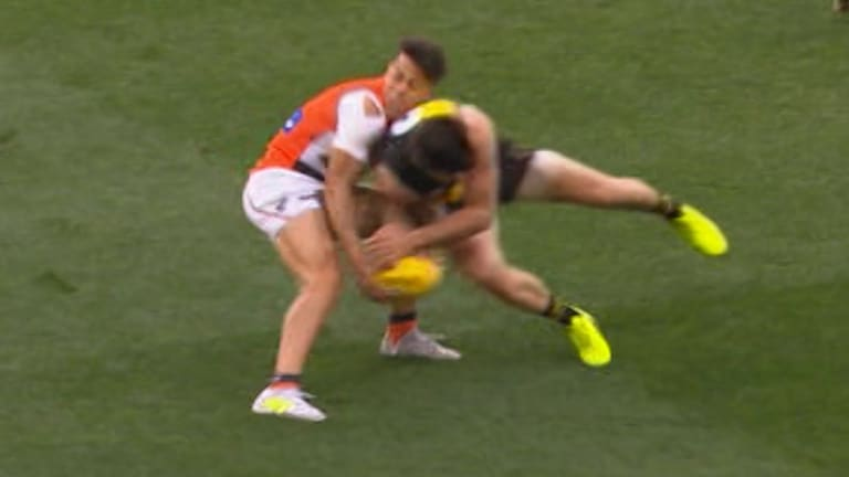 Concussed: The hit by Trent Cotchin that ended Dylan Shiel's preliminary final.
