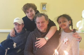 Robert Pether, who has been detained in Iraq since April, pictured with his three children.