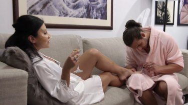 Oblivious to the drama, Michael paints Martha's toenails as they celebrate their one-month anniversary.