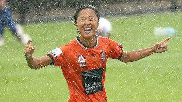 Raining goals: Yuki Nagasato celebrates after scoring for Brisbane.