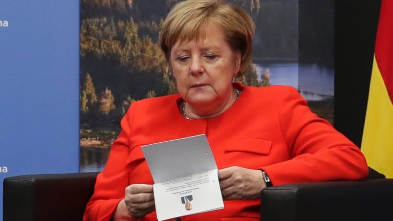 German Chancellor Angela Merkel checks her notes during a bilateral meeting with Prime Minister Scott Morrison at the G20 summit in Buenos Aires in Argentina on Saturday.