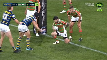Rabbitohs halfback Adam Reynolds gets up after suffering a fractured back in the 6th minute of the Eels clash.