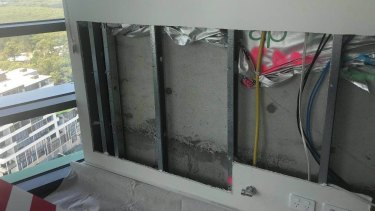 A wall that has been cut out inside an Opal Tower apartment.