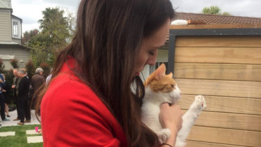 Jacinda Ardern with her cat Paddles outside her Point Chevalier home the day after the 2017 election.