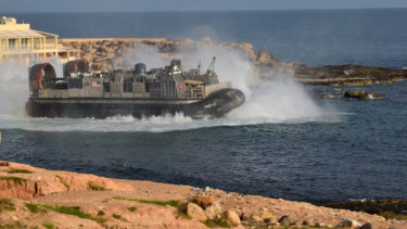 A US amphibious hovercraft departs with evacuees from Janzur, west of Tripoli, on Sunday.