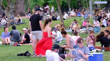 People relaxing at the Edinburgh Gardens in Fitzroy.