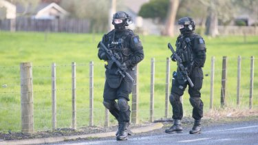 NZ Armed Offenders Squad members near the scene.