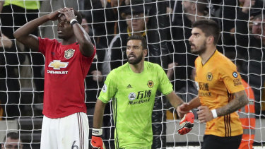Paul Pogba reacts to his missed penalty, which sparked a torrent of racial abuse online.