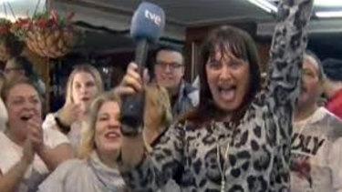 Spanish reporter Natalia Escudero celebrates her El Gordo win on live TV.