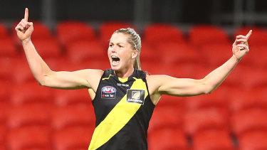Richmond star Katie Brennan celebrates one of her three goals against Gold Coast at Metricon Stadium on Friday night.