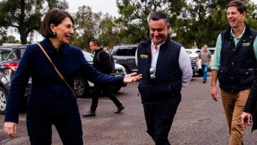 Victors despite several  scandals ... Premier Gladys Berejiklian and Deputy Premier John Barilaro in Muswellbrook on Saturday, election day, with the winning Nationals candidate Dave Layzell.