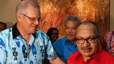 Prime Minister Scott Morrison with Papua New Guinea's Prime Minister Peter O'Neill after APEC last year.
