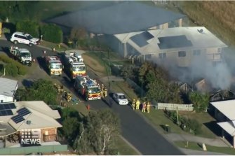 The smouldering house in Kilcoy in which two people died on Saturday afternoon.