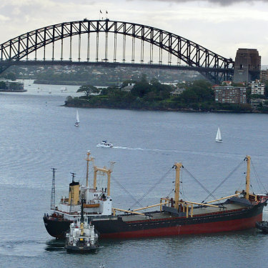 The North Korean drug-running vessel the Pong Su being brought into Sydney Harbour under police guard in 2003.