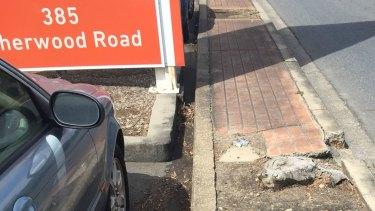 Damaged footpath on Sherwood Road, Rocklea