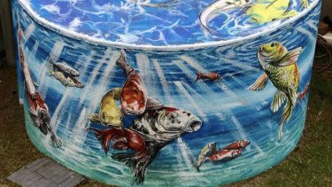 A mural of koi fish, painted by Simon White on a water tank in Loch Sport.