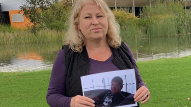 Leith Masters holds a picture of her missing brother.