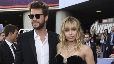 Liam Hemsworth, left, and Miley Cyrus at the premiere of Avengers: Endgame in Los Angeles in April.