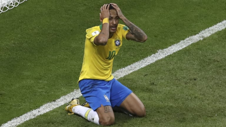 Hands on heads: Neymar reacts to a missed opportunity, or being denied a penalty - it's hard to tell.
