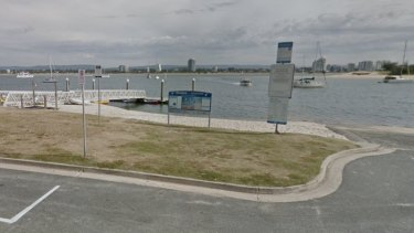 A man was pulled unconscious from the water off Muriel Henchman Drive at the Gold Coast.