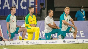 The Australian team takes a knee before their T20 clash with the West Indies.