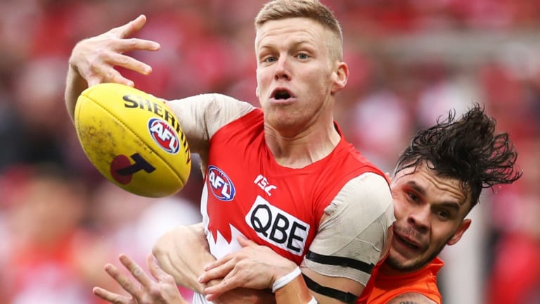 Caught: Zac Williams tackles Daniel Hannebery in possession.