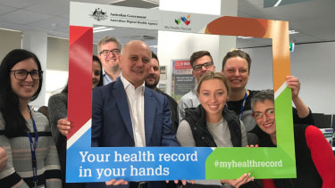 Tim Kelsey (centre), head the Australian Digital Health Agency, which is rolling out My Health Record.