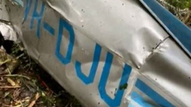 Wreckage from the light plane that crashed in northern NSW killing a father and his son.