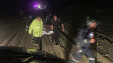 The young victim was carried on a stretcher to the waiting helicopter and flown to Brisbane for further treatment.
