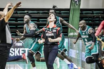 """Coach Liz"" celebrates a memorable victory for Kenya."