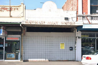 The boarded-up Footscray shop where a family plans to build their eight-storey home.