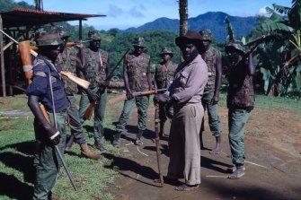 Meeting rebel leader Francis Ona.