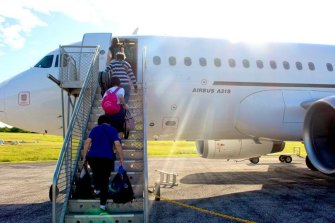 Australians who were evacuated from Wuhan leave Christmas Island on Tuesday.
