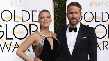 Blake Lively and Ryan Reynolds arrive at the Golden Globe Awards.