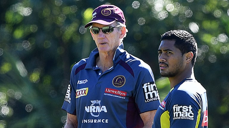 Protective: Wayne Bennett and Anthony Milford.