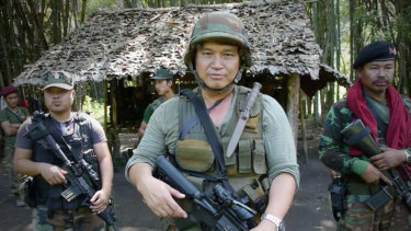 Major General Nerdah Bo Mya in front of one of the huts at Mu Aye Pu.