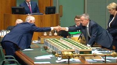 Malcolm Turnbull and Bill Shorten shake hands on Wednesday.