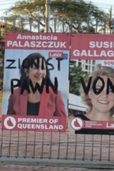 A campaign poster of Premier Annastacia Palaszczuk was targeted with graffiti in 2020.