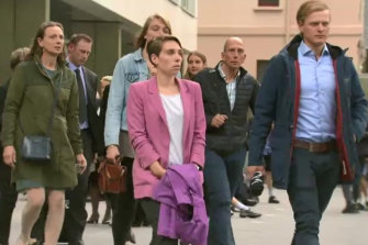 Gitta Scheenhouwer's mother (far left) and boyfriend Thomas Kleinegris (far right) leave court with other family members on Wednesday.