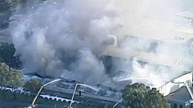 Up to 60 firefighters are battling a huge factory fire in Somerton in Melbourne's north, which is sending plumes of smoke into surrounding communities.