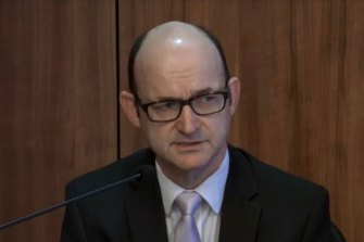 Victoria Police's head of legal services, Findlay McRae, gives evidence at the royal commission