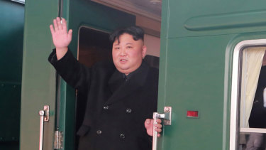 The North Korean dictator Kim Jong-un pictured boarding the train bound for Hanoi from Pyongyang Station in North Korea on Sunday.