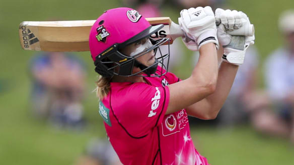 Superstar: Ellyse Perry hits a six to win the game and send the Sixers into the Women's Big Bash League final.